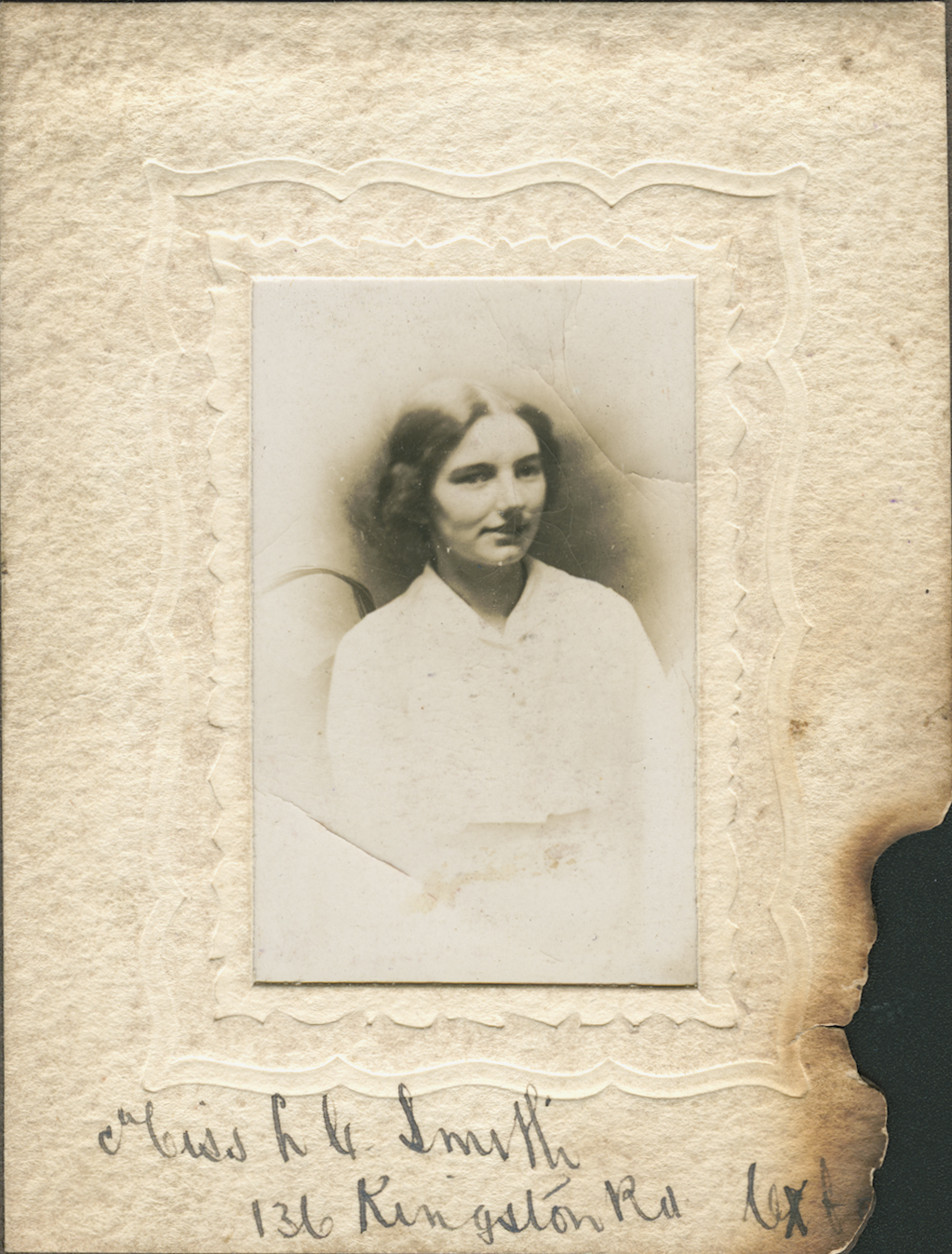 The burnt photograph of Lilah, Smith's sister (also photographed with Smith above) which was found on his body.