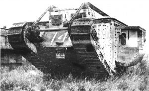 The Mark IV male tank fitted with Renolds chain unditching gear, seen on the original Tank Museum at Bovington shortly after the First World War. Note the rollers that carry the chains around the tank until they vanish underneath.