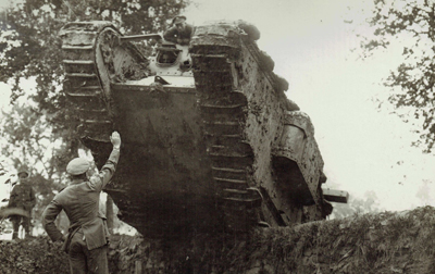 A Mark IV (female) tank, climbing a ridge while practising, in 1917. It has grousers fitted to the tracks and you can just see the end of the unditching bean sticking out on the right.
