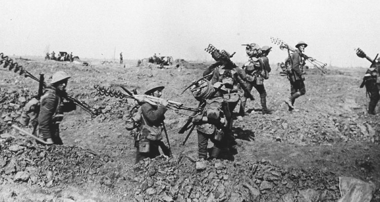 British infantry carrying barbed wire pickets forward.