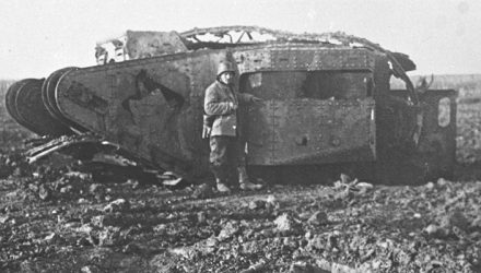 German beside captured tank