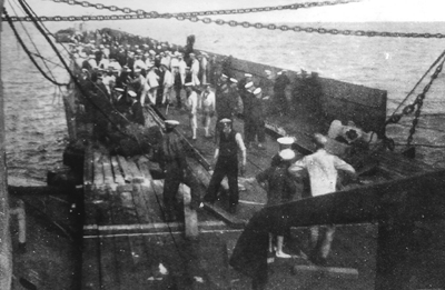 Sailors checking over the pontoon, photograph taken from the gangway leading from the port side Monitor.